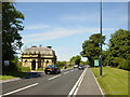 SJ3576 : Welsh Road (A550) and Dehon House Lodge by Sue Adair