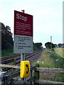 SJ5845 : Warning sign at level crossing by Nigel Williams