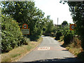 TL1199 : The road into Ailsworth by Terry McKenna