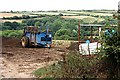 SW7855 : Farm Machinery and Valley by Tony Atkin