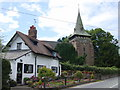 SJ3673 : Rose Cottage and Holy Trinity, Capenhurst by Sue Adair
