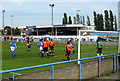 Dist:0.2km<br/>Wivenhoe Town (in the Orange Shirts) defend against Wingate & Finchley FC during a Ryman League Division 1 North match.   In the background is the main stand of the Harry Abrahams Stadium.  Go to [[[236663]]] to see a Penalty