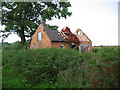 SJ6947 : Derelict farm building by Badgers Farm by Espresso Addict