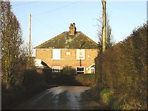 TR2860 : House on Knell Lane at junction with road from Goldstone. by Nick Smith