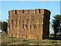 TG2136 : Haystack on a field opposite Roughton church by Bernd Jatzwauk