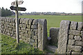 SD9527 : Footpath junction and stile near Hippins by Phil Champion