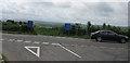 SX2384 : Cross roads on A395 by Jon Coupland
