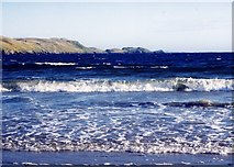 HU3447 : Breaking waves and Fora Ness, Sand, Shetland by Ruth Sharville