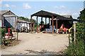 SX3288 : Werrington: farm at Ladycross by Martin Bodman