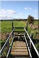 SJ3560 : Footbridge over the border by Paul Roberts