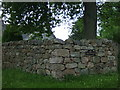 Dist:0.3km<br/>Garden wall with nameplate.