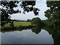 SD7913 : Looking towards Holcombe Hill from the weir at Burrs by Nigel Catterall