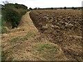 TF3165 : Ploughed field at Hameringham Top by Dave Hitchborne