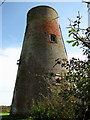 TG3925 : Disused windmill near Mill Farm by Evelyn Simak