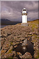NH0997 : Rubha Cadail lighthouse, with reflection in rockpool by Ian Capper