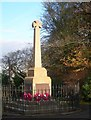 "Coylton Parish War Memorial, a few days after Remembrance Sunday.  This cross of white granite was designed by one of Hillhead's most famous sons, Robert Bryden, who was an accomplished sculptor.  (Source: ""Ayrshire: Discovering A County"", by Dane Love)."