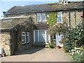SE1241 : Cottage behind Eldwick Hall by Tony Murgatroyd