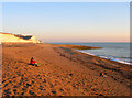 TQ3801 : Basking in the Winter Sun, Saltdean Beach by Simon Carey