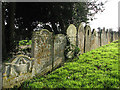 TG1111 : St Andrew's Church  - row of gravestones in churchyard : Week 4