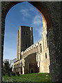 TG1001 : Wymondham Abbey - west tower viewed through ruined doorway by Evelyn Simak