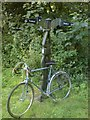 SN4905 : Bike leaning against cycle path mile post by Hywel Williams