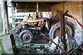 TL2769 : Retired tractor in derelict farm buildings by Duncan Grey