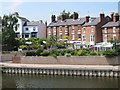 SJ5013 : Houses up stream from the weir by Dave Croker