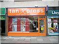 SU6505 : Tan Xpress in Cosham High Street by Basher Eyre