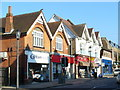 Dist:0.2km<br/>Few chain store outlets in the main shopping street of the exclusive Surrey town of Cobham.