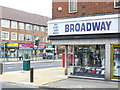 Dist:0.1km<br/>A corner shop on Tolworth Broadway, a busy dual-carriageway and main road between Epsom and Kingston-on-Thames. It has a variety of local shops, many now taking on ethnic tinges. Above the shops are flats.