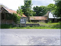 R4596 : Derelict buildings at road junction - Cregmahon Townland by Mac McCarron