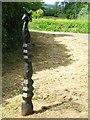 J3067 : Millennium milepost near Drumbeg by Rossographer