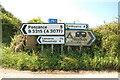 SW4224 : Road signs, Boskenna Cross by Mari Buckley