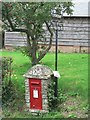 SU0611 : Edmondsham: postbox № BH21 115 and old post office sign by Chris Downer