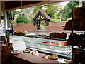 SP0783 : St. Mary's lychgate as seen from inside the La Patisserie café by J Taylor