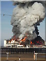 ST3161 : The Grand Pier in flames by Chris Borrison