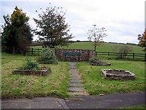 NZ3343 : Community garden at Littletown crossroads by Roger Smith