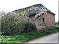 TG4622 : Dilapidated 18th century brick barn by Evelyn Simak