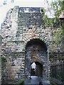 NZ2563 : Gateway in castle walls by Mike Quinn