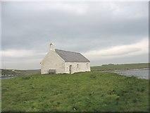 SH3368 : Eglwys St Cwyfan Church from the graveyard by Eric Jones
