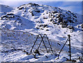 NY2910 : Skeleton of old fence and stile at head of Easedale 1986 by Tom Richardson