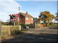 TG3023 : Gatehouse beside level crossing on Roman Road by Evelyn Simak