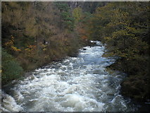SH5946 : The river Glaslyn in full flow from Pont Aberglaslyn by Dave Beynon
