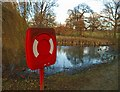 SE2708 : Life buoy near a very small pond in Cannon Hall country park by Steve  Fareham