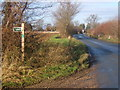 TM0347 : New Road and start of footpath by Andrew Hill