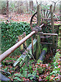 TG2726 : A sluice in the woods - remains of the sluice gate by Evelyn Simak