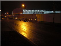 TL8364 : Asda store, building site lit at night by John Goldsmith