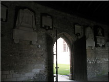 SU8504 : Plaques on the cloister walls at Chichester Cathedral by Basher Eyre