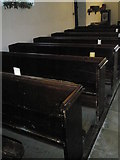 SU8014 : Ancient pews within  St Peter, East Marden by Basher Eyre