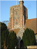 TR3548 : The brick and flint tower of Ringwould's St Nicholas church by Nick Smith